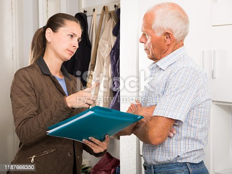 Female collector is trying to get the arrears from mature man at home door