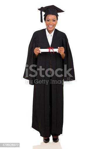 istock female college graduate in gown and cap 478928972