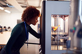 istock Female College Student Studying Engineering Using 3D Printing Machine 1218975926