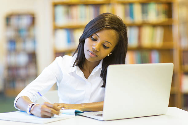 female college student studying stock photo