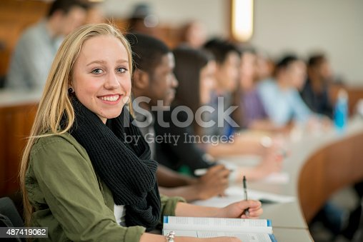 istock Female College Student Taking Notes During a Lecture 487419062