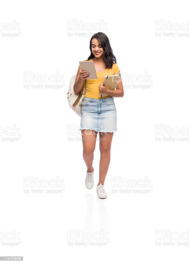Front view shot of a female college student using her portable...