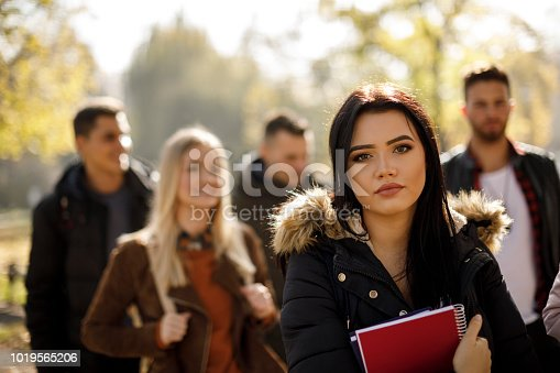 872670290istockphoto Female college student with books outdoors 1019565206