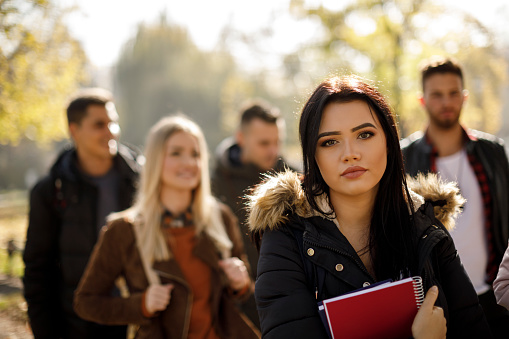 872670290 istock photo Female college student with books outdoors 1019565206