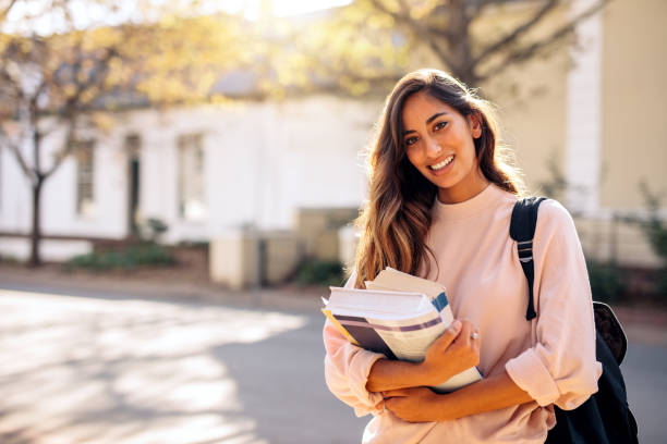 female college student with books outdoors - student stock photos and pictures