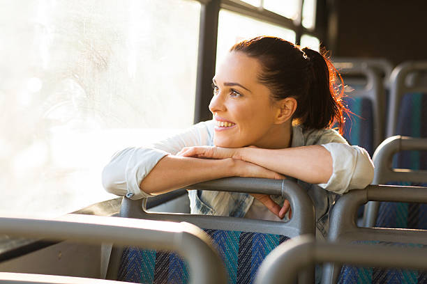female commuter daydreaming on bus stock photo