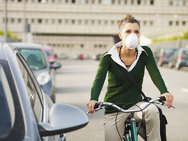 female commuter  pollution mask stock pictures, royalty-free photos & images