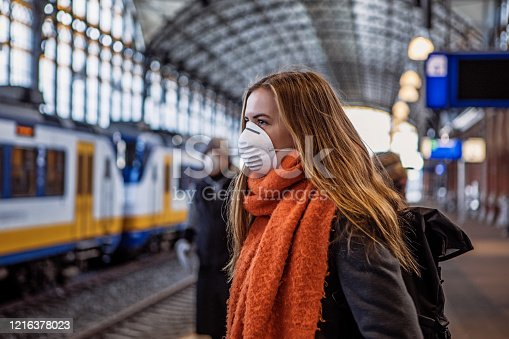 istock Female commuter using public transport during virus outbreak 1216378023