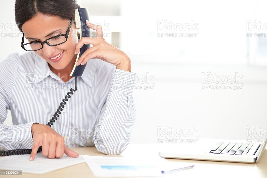 Female company worker talking on the phone royalty-free stock photo