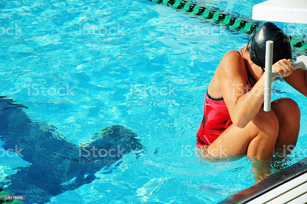 Female Competitive Swimmer at Start stock photo