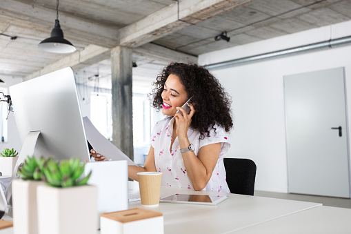 Female Computer Programmer Talking On Phone Stock Photo - Download Image Now