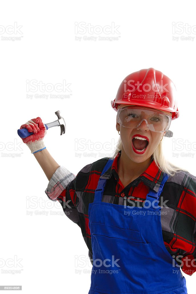 female construction worker in dungarees stock photo
