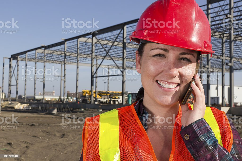 Female Construction Worker on the Phone royalty-free stock photo