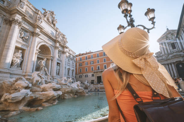 Female contemplating the Trevi fountain in Rome, Italy stock photo