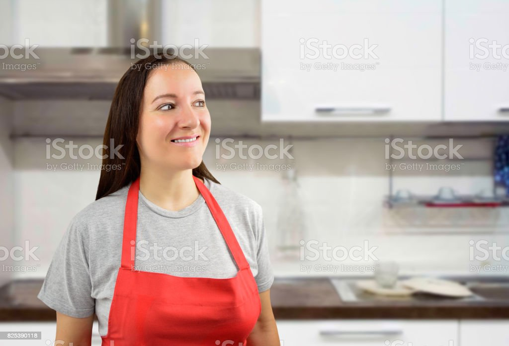 Female cook looking askance stock photo