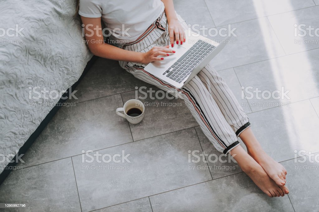 Female copywriter using the laptop for work stock photo