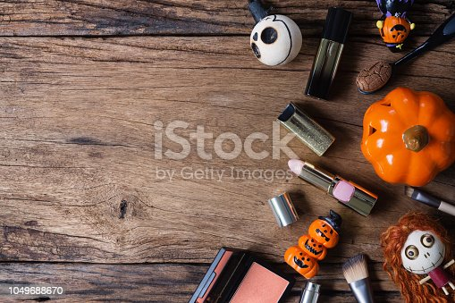 istock Female cosmetics sales discount in Halloween festival background concept. Flat lay top view with copy space for your text. 1049688670