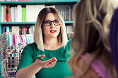 istock Female counselor talks with a client 1016605194