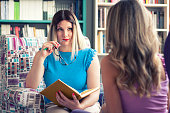 istock Female counselor talks with a client 1016605234