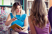 istock Female counselor talks with a client 1016605266