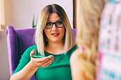 istock Female counselor talks with a client 1028249452