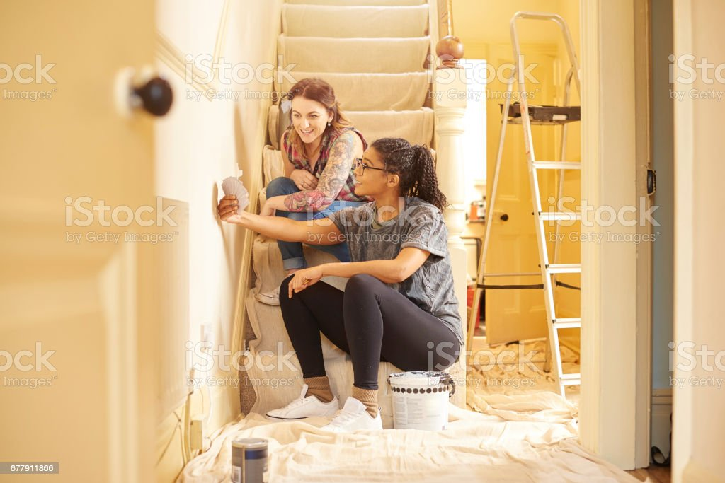 female couple choosing swatch colours royalty-free stock photo