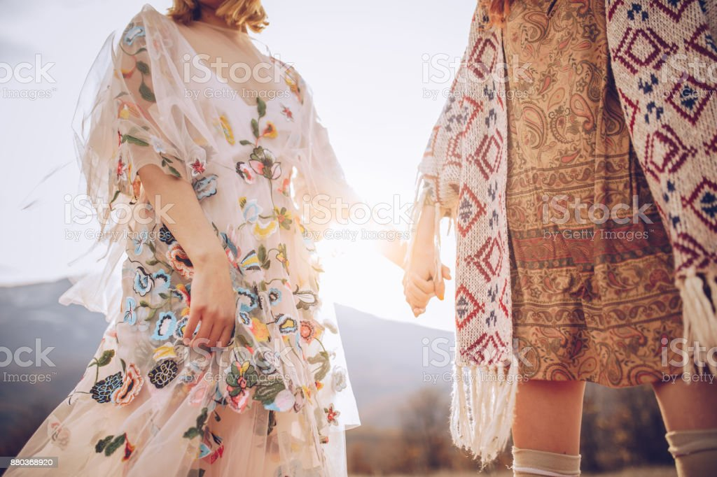 Female couple holding hands stock photo