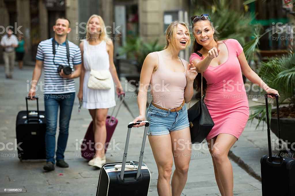 female couple tourists taking walk stock photo