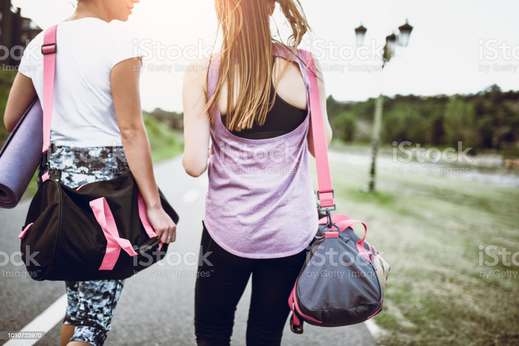 Female Couple Walking And Searching For A Location To Work Out In Park