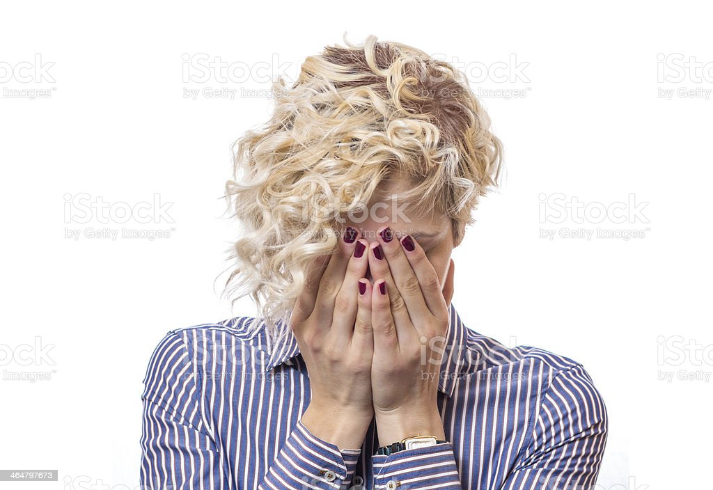 Female  covered own face with their hands stock photo
