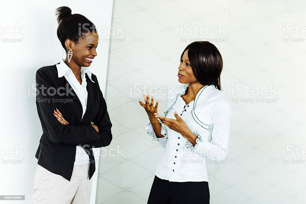 Female co-workers discussing royalty-free stock photo