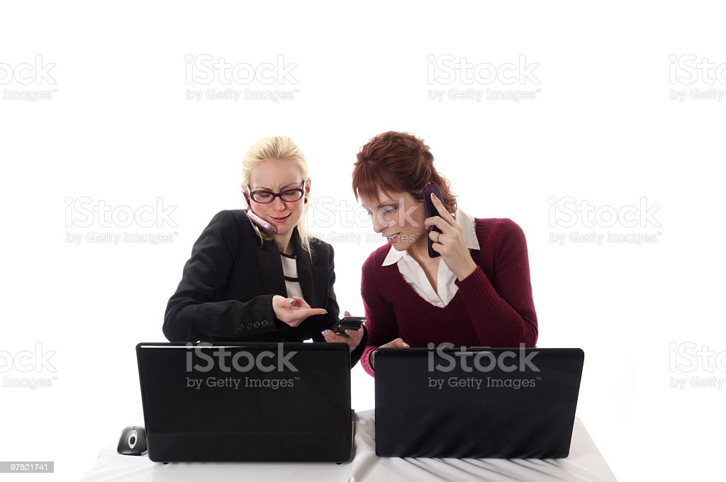 Female coworkers looking at cell phone. royalty-free stock photo