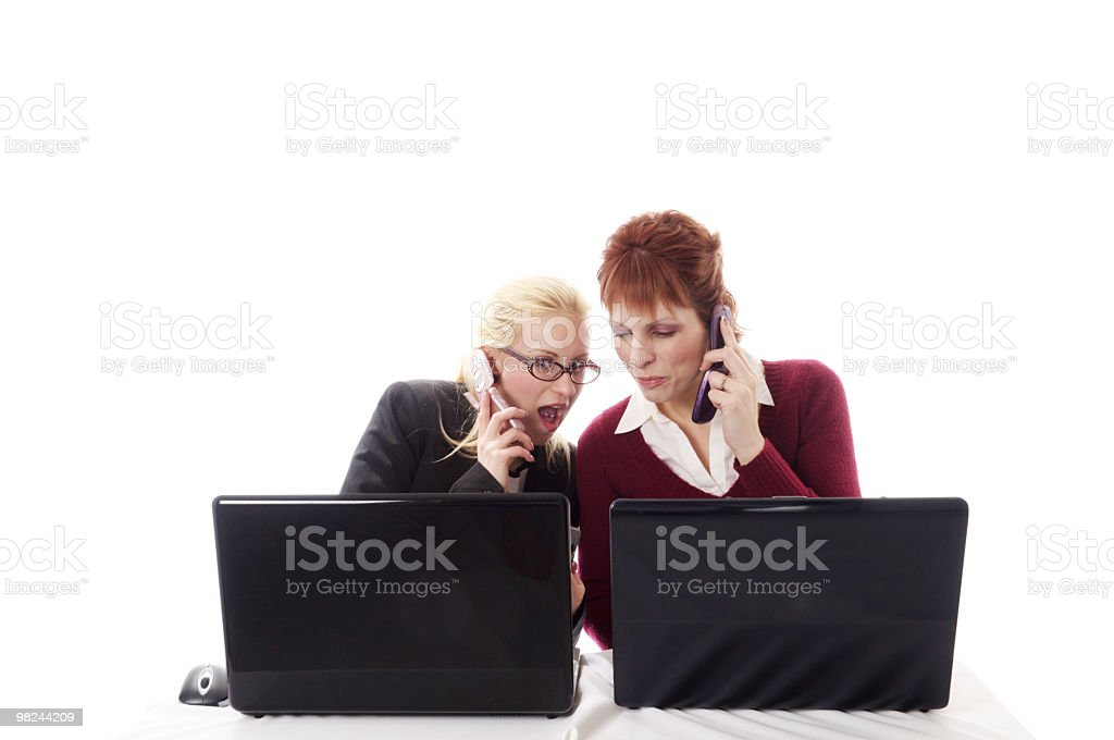 Female coworkers react to info on cell phone. royalty-free stock photo