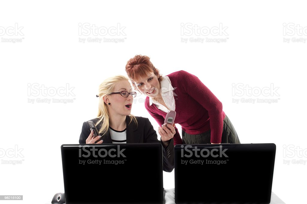 Female coworkers react to text message. royalty-free stock photo