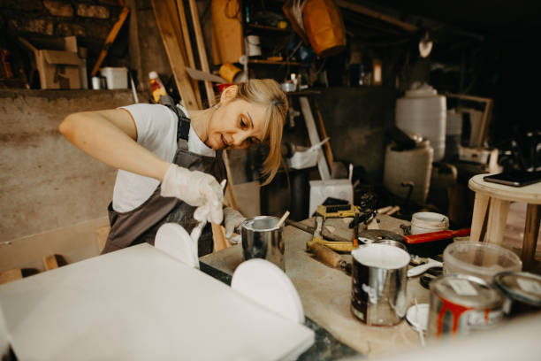Female craftsman in isolation making props for newborn photography stock photo