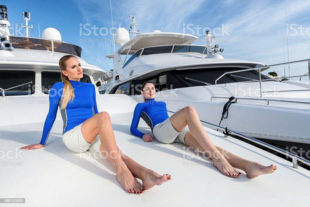 Female crew members on luxury yacht stock photo