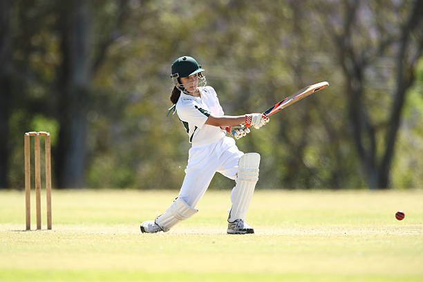 Female Cricketer Batting - Photo