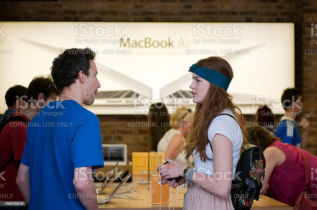 Female customer at Apple Store, London stock photo