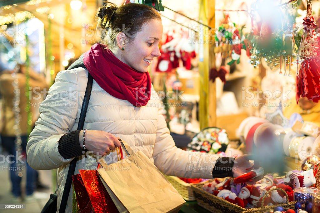 Female customer at the Christmas Fair royalty-free stock photo