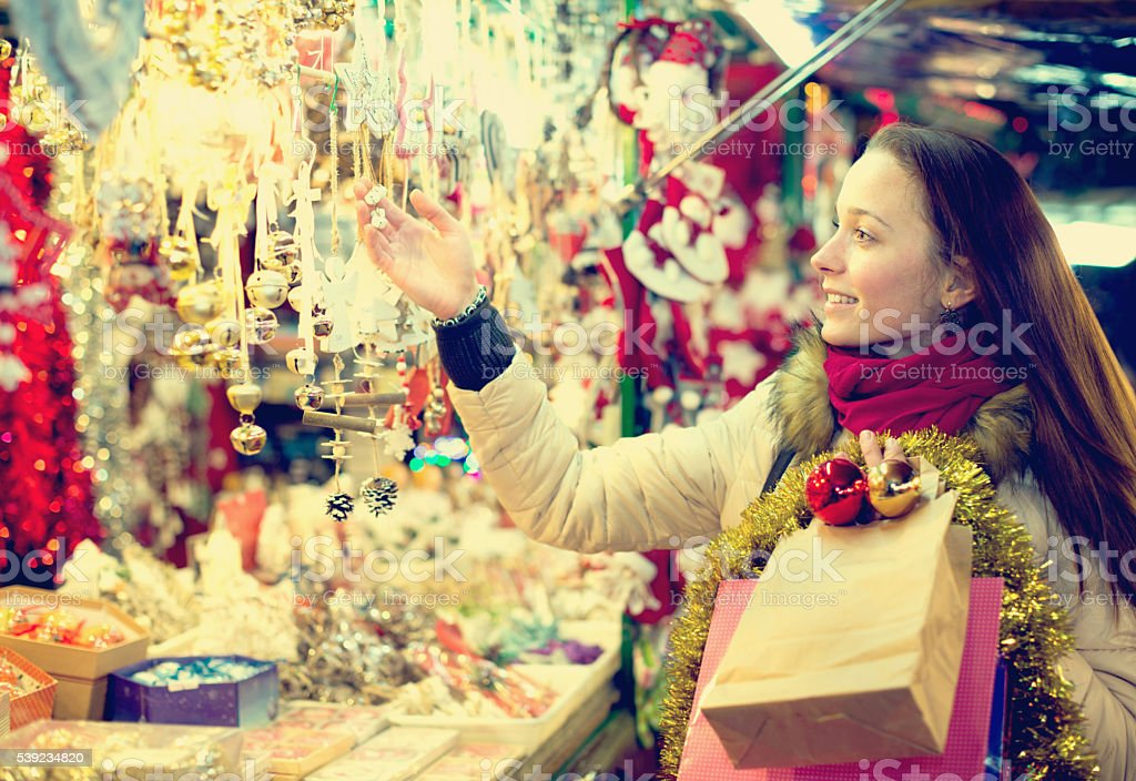 Female customer at the Christmas Fair royalty-free stock photo