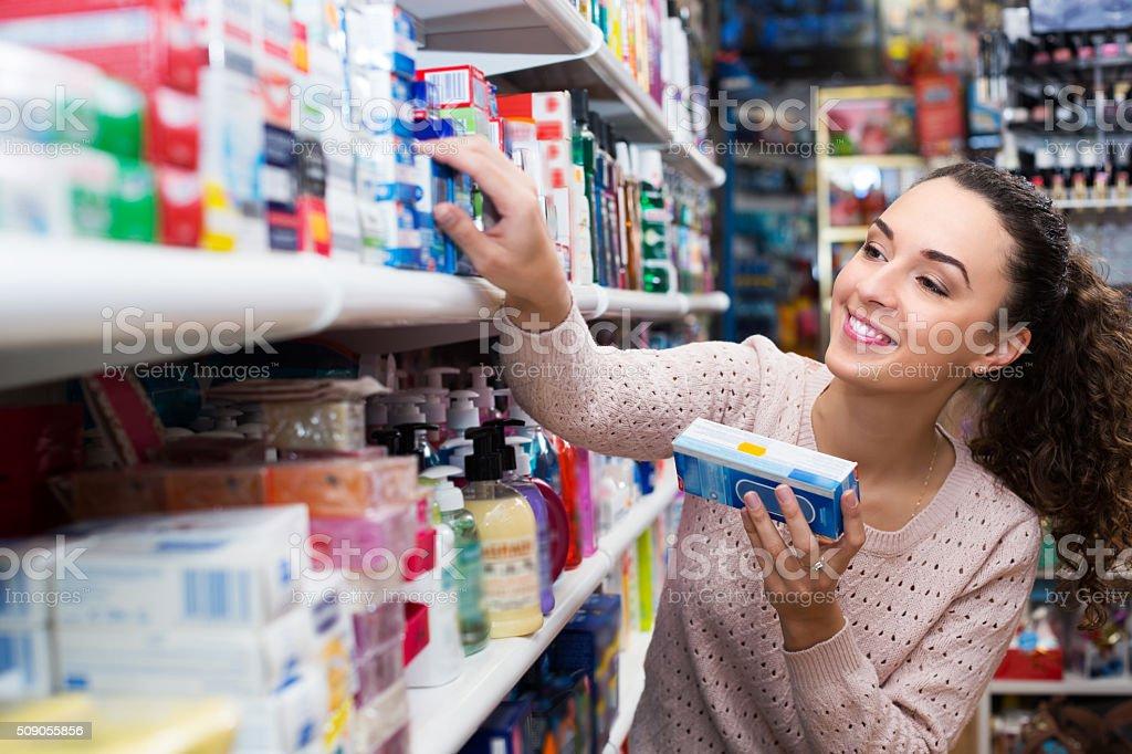 Female customer buying toothpaste stock photo