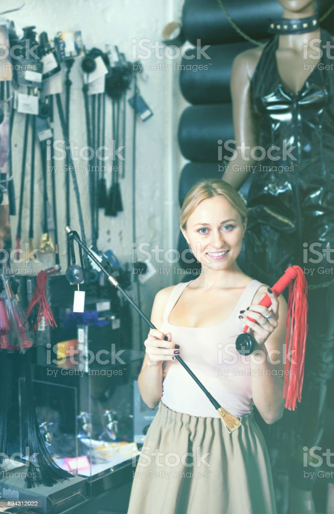 Female customer in adult products store stock photo