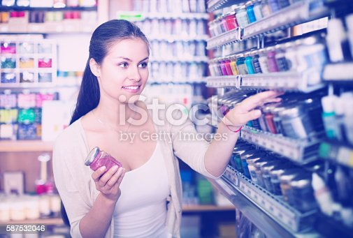 istock female customer in art department 587532046