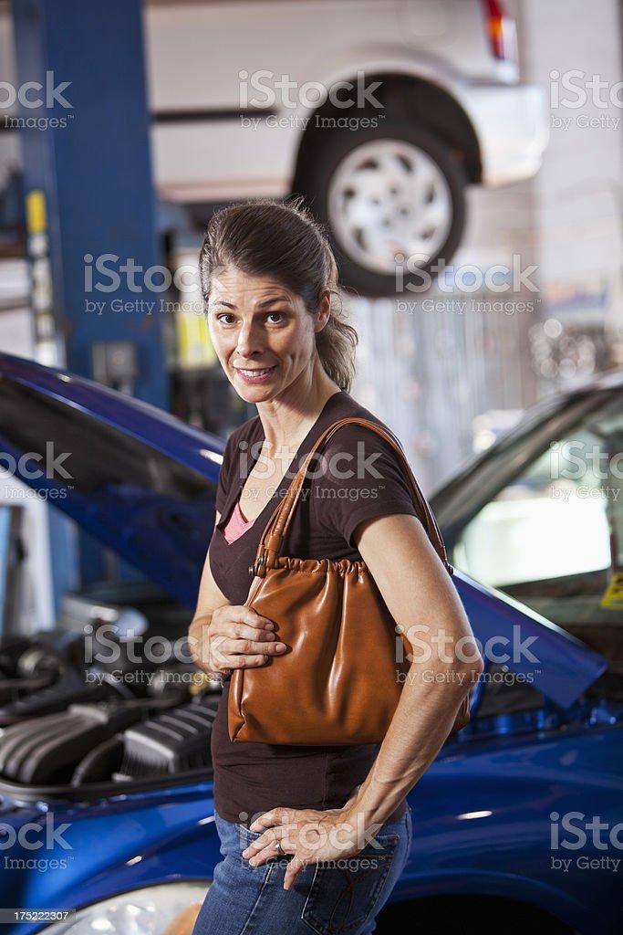 Female customer in auto repair shop stock photo