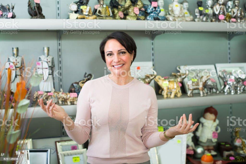 Female customer in souvenir shop stock photo