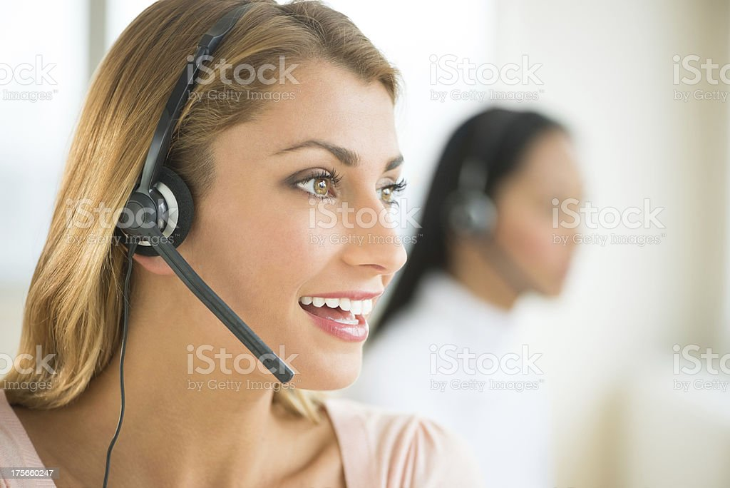 Female customer service representative on the phone stock photo