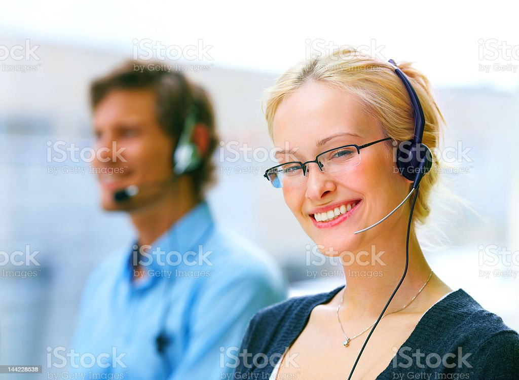 Female customer service representative smiling royalty-free stock photo