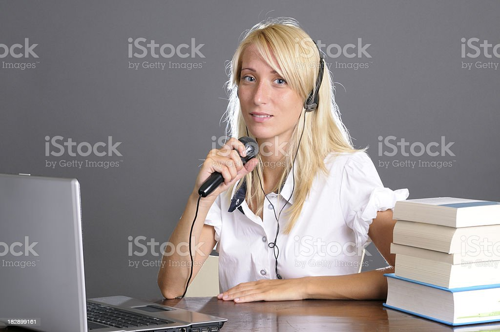 Female Customer Service with Headphones Using PC royalty-free stock photo