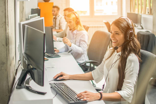 Female customer services agent with Headset working in a call center stock photo