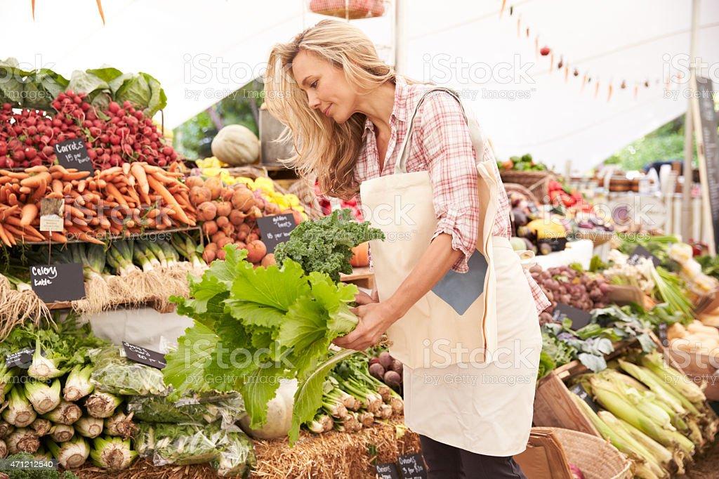 Female Customer Shopping At Farmers Market Stall stock photo